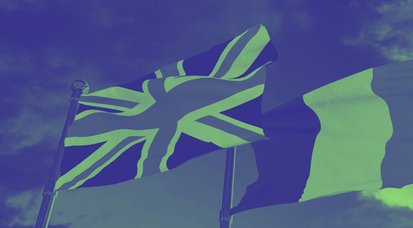 An image of the union jack next to the Italian flag, both fluttering in the wind