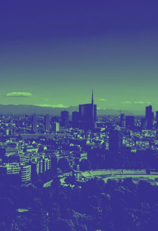 A photograph of a city skyline, colourised in green and blue